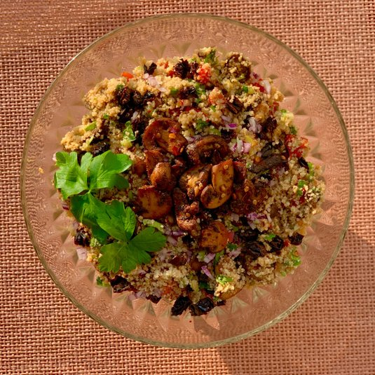 15-minute couscous salad topped with spicy mushrooms